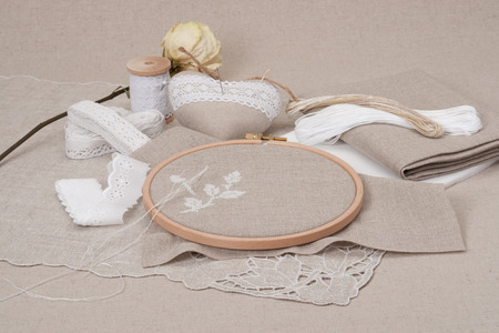 Sewing And Embroidery Craft Kit. Dried Rose. Natural Linen Background photo