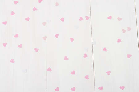 Paper Hearts On White Wooden Table. photo
