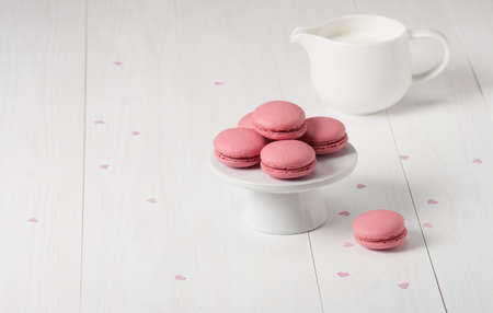 Macaroons Biscuits On White Stand. Paper Hearts. photo