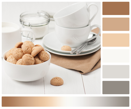 complimentary: Amaretti Biscuits. Kitchenware. White Wooden Table. Palette With Complimentary Colour Swatches.