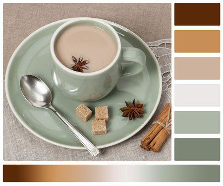 complimentary: Cup Of Coffee, Cocoa or Tea With Milk And Spices. Old Silver Spoon. Natural Linen Table Cloth. Palette With Complimentary Colour Swatches. Stock Photo