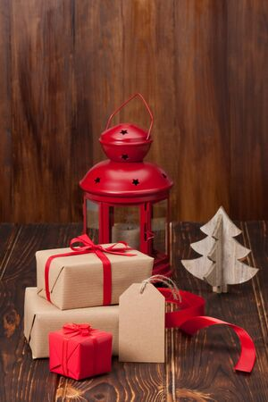 blank tag: Gift Box With Blank Tag. Christmas Decorations. Wooden Background. Stock Photo