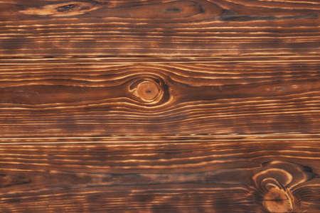 quemado: Café oscuro quemado textura de madera, fondo. Foto de archivo