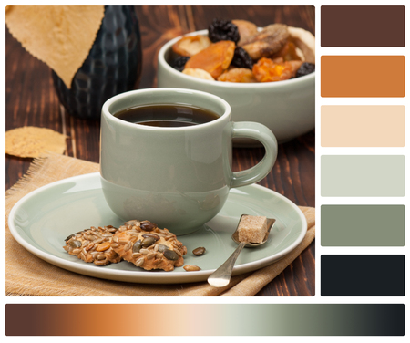 complimentary: Autumn Concept. Cup Of Tea Or Coffee. Dried Fruits. Cookies With Seeds. Wooden Background. Palette With Complimentary Colour Swatches.