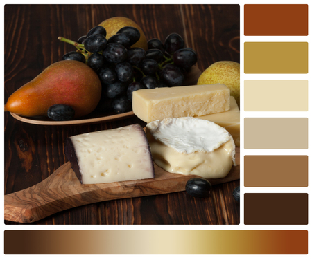 complimentary: Assorted Cheese On Slate Stone. Grapes, Pears. Palette With Complimentary Colour Swatches.