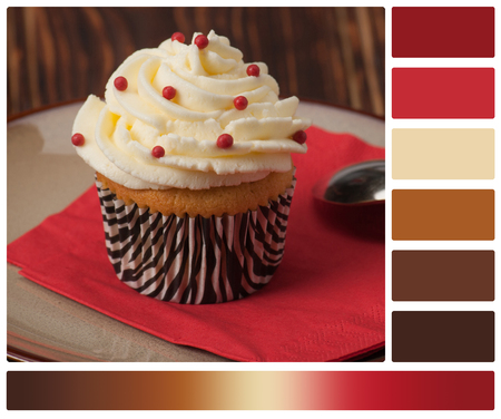 complimentary: Cupcake With Cream And Sprinkles. Palette With Complimentary Colour Swatches. Stock Photo
