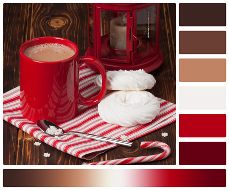 warm color: Hot Chocolate Drink. Christmas Sweets And Decorations. Wooden Background. Palette With Complimentary Colour Swatches. Stock Photo
