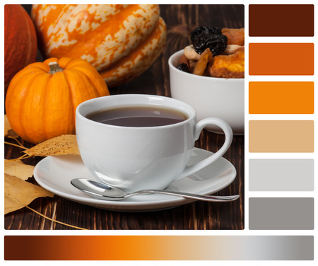 autumn colour: Autumn Concept. Cup Of Tea Or Coffee. Dried Fruits. Pumpkins. Wooden Background. Palette With Complimentary Colour Swatches. Stock Photo