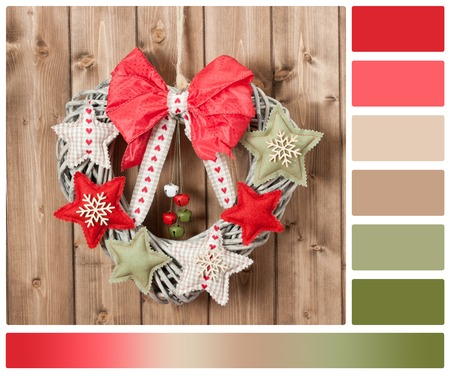 complimentary: Christmas Wreath Decorated With Handmade Textile Stars And Bells Garland. Wooden Background. Palette With Complimentary Colour Swatches