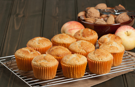 Homebaked Cupcakes In Paper Cases. Wooden Table. Apples. Nuts Stock Photo
