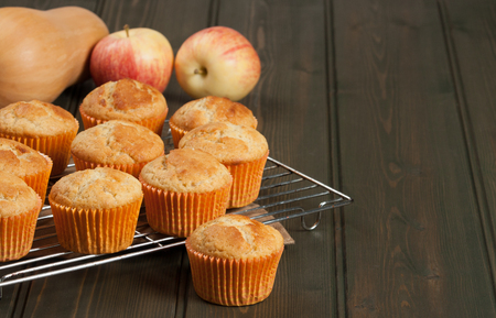 Homebaked Cupcakes In Paper Cases. Wooden Table. Pumpkins. Apples Stock Photo