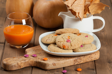carrot tree: Homebaked Chewable Butter Biscuits With Colored Chocolate Sweets. Carrot Juice. Olive Tree Board. Autumn Leaves. Pumpkins