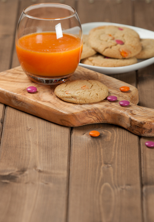 carrot tree: Homebaked Chewable Butter Biscuits With Colored Chocolate Sweets. Carrot Juice. Olive Tree Board. Autumn Leaves