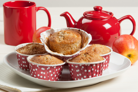 Homebaked Apple Muffins In Paper Cases. Red Teapot