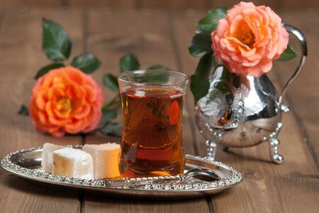Turkish Delight. Hot Tea. Persimmon. Rose. Silver Dish Stock Photo