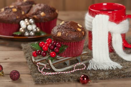 Chocolate Muffins With White Chocolate Chips. Mug Of Tea Or Coffee. Christmas Decorations