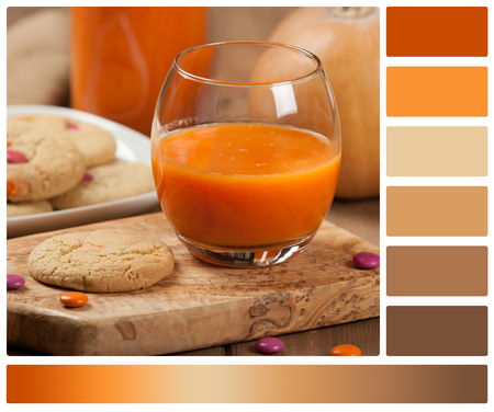 complimentary: Homebaked Chewable Butter Biscuits With Colored Chocolate Sweets. Carrot Juice. Palette With Complimentary Color Swatches
