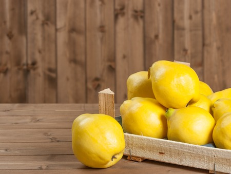 Ripe Quince Fruits In Wooden Box Stock Photo