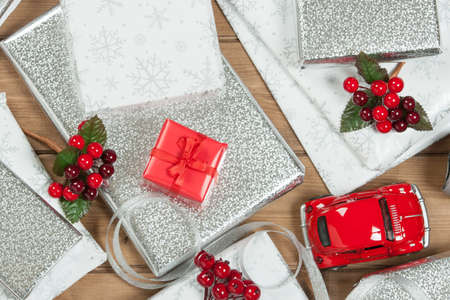 Group Of Wrapped Christmas Gifts, Silver Wrapping Paper, Decorations ...