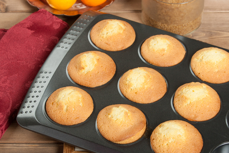 Homebaked Upside Down Clementine Muffins In Baking Tray Stock Photo