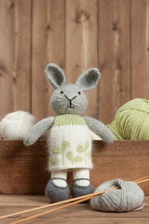 Handmade Knitted Rabbit Soft Toy. Yarn Balls. Wooden Knit Needles
