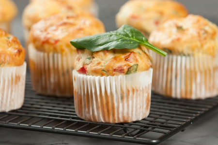 Home Baked Cheese And Vegetables Muffins With Pepper, Spinach, Sweetcorn, Mature Gouda Stock Photo