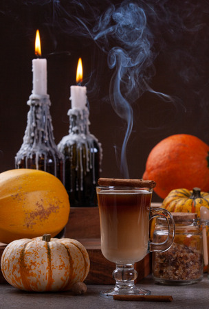 Autumn Concept. Glass Of Spicy Pumpkin Latte On Dark Moody Background. Imagens