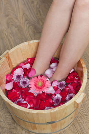 A young woman does foot bath  photo
