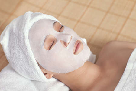 Facial mask for the young lady at spa