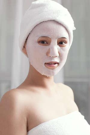 busts:  Facial mask for the young lady at spa  Stock Photo