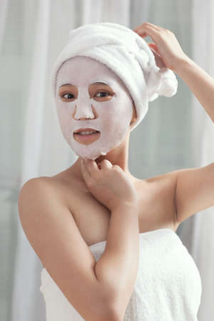 Facial mask for the young lady at spa  photo