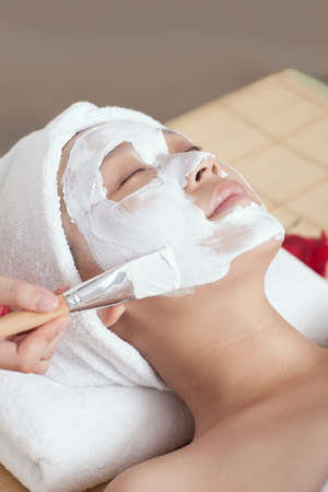 A young woman enjoying spa mask  photo