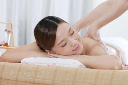 A young woman enjoying massage  photo