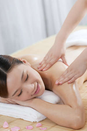 A young woman enjoying massage  photo