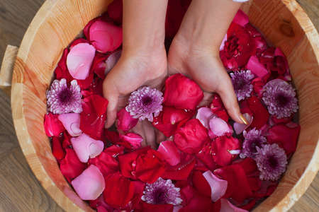 Hands spa with flowers for young lady  photo