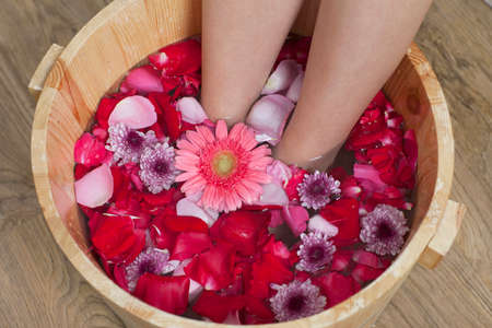 Foot bath with flowers in spa salon