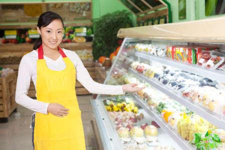 A young shop assistant Imagens