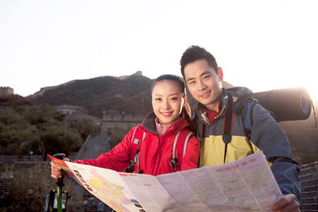 A young couple using map in the Great Wall Stok Fotoğraf