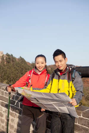 Young couples in the Great Wall using map