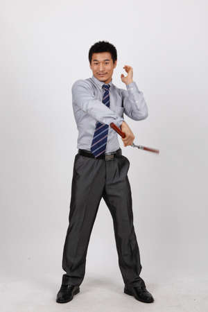 A business man with a double stick