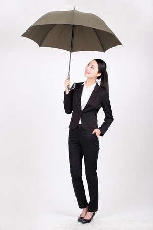 A business woman holding an umbrella
