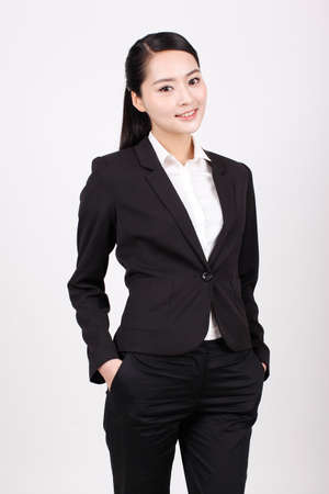 A young business woman standing