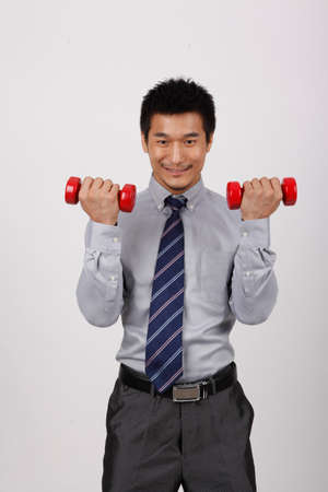 A business man with dumbbells