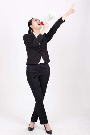 A business woman holding a megaphone