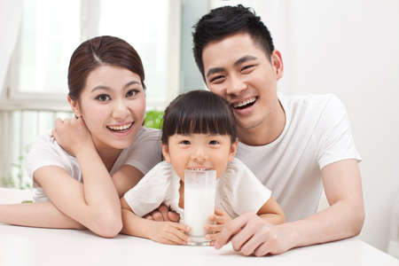 Healthy family and daughter drinking milk