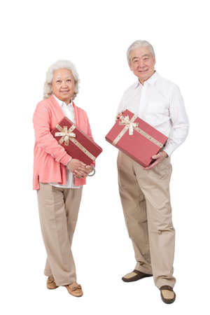 Senior couple holding gift box