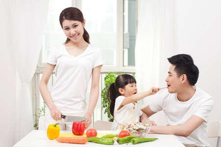 Family preparing a salad