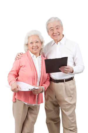 Senior couple holding questionnaire