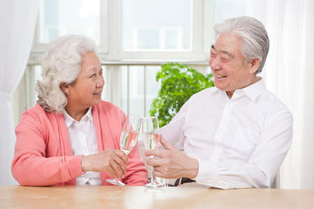 Senior couple toasting for anniversary