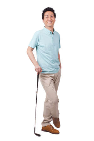 Young man holding golf swing and smiling